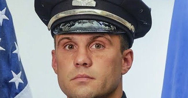 Boston officer improving after surgery to remove bullet