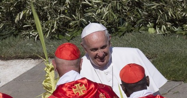 Pope prays for plane crash dead during Palm Sunday Mass