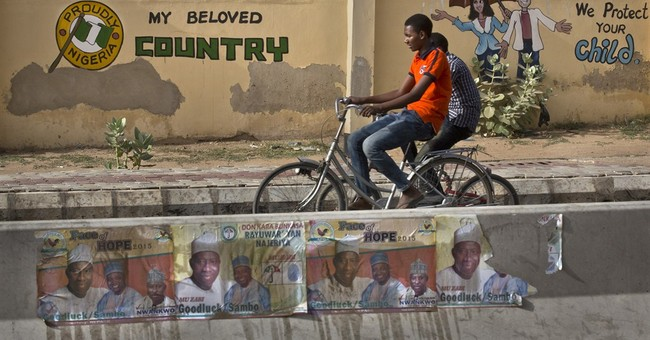 Nigerians vote Sunday despite violence, technical hitches