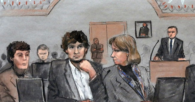 Marathon bombing jurors see autopsy photos, prosecutors rest