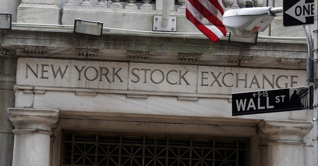 Stocks slide on falling wages, oil slump