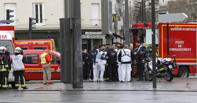 Hostage-taker at Paris market linked to newspaper attack