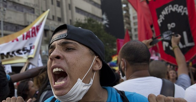 Protesters decry bus and subways fare hikes in Brazil
