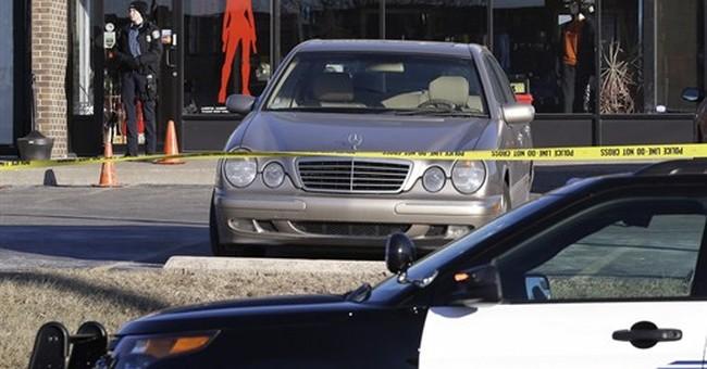 Owner dies after shootings at suburban Kansas City gun shop