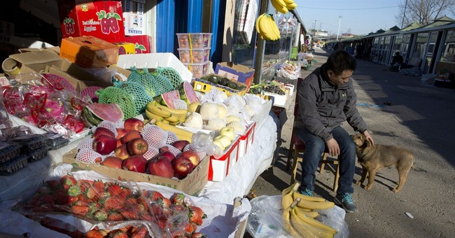 China's inflation edges up in December