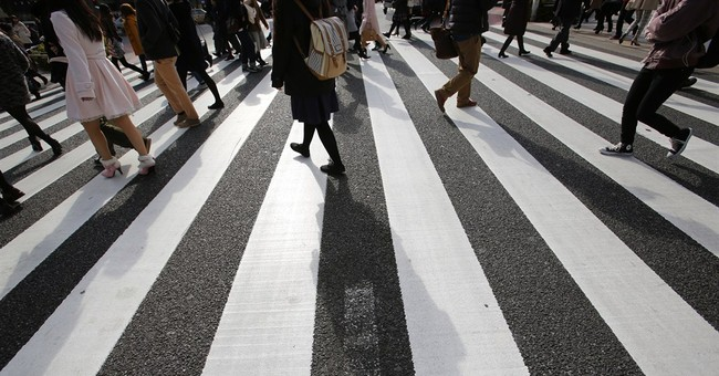 Japan tankan survey: businesses wary, spending plans flat