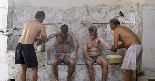 AP PHOTOS: Time slowly washing away Iran's public bathhouses