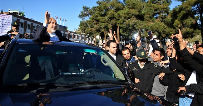 Iran president promises nation will abide by nuclear deal