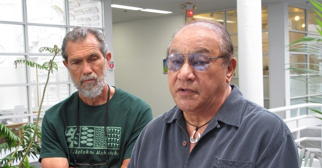 Hawaiian leader seeks construction pause at sacred summit