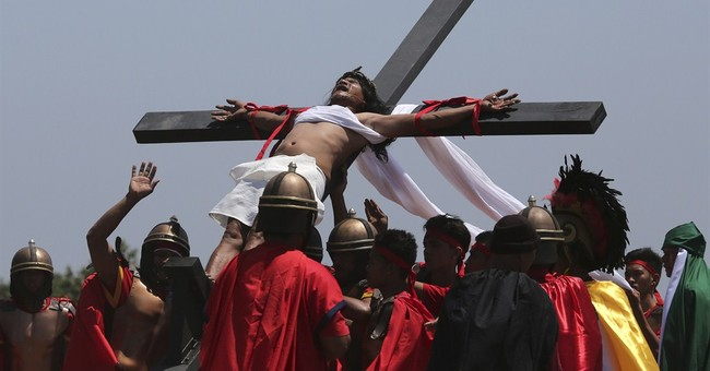 Filipino devotees nailed to crosses in Good Friday rites