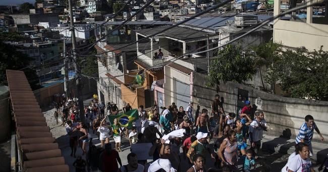 Slum dwellers protest over boy's death in Brazil shantytown