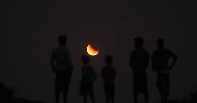 Unusually short total lunar eclipse dazzles skywatchers