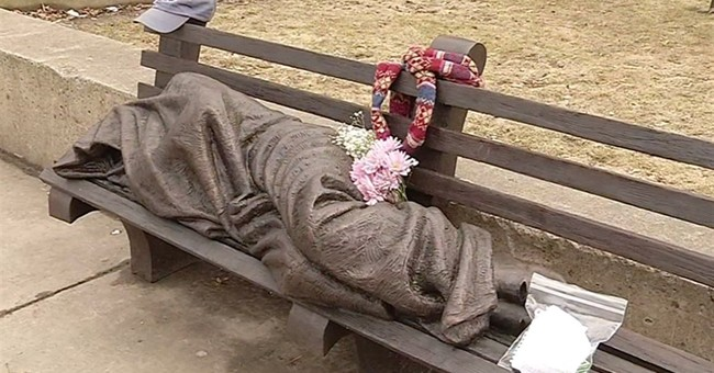 Gifts being left at homeless Jesus statue at Buffalo church