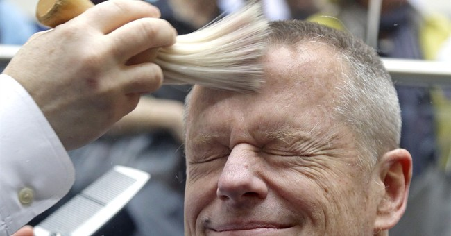 Massachusetts governor gets head shaved to support charity