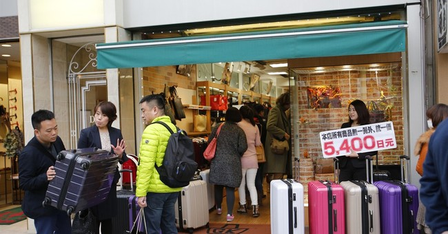 China to keep track of its tourists' unruly behavior abroad