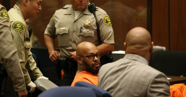 'Suge' Knight comes to court for robbery case in wheelchair