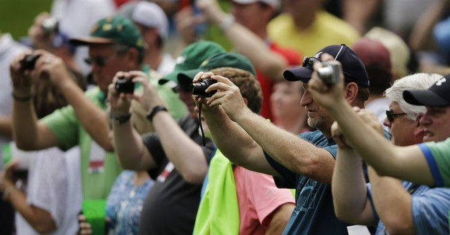 Back to the future: Shutterbugs out in force at the Masters