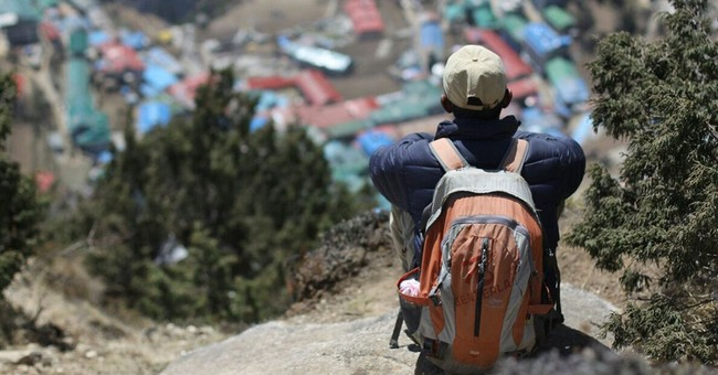 Image of Asia: Resting on the slopes above Sherpa village