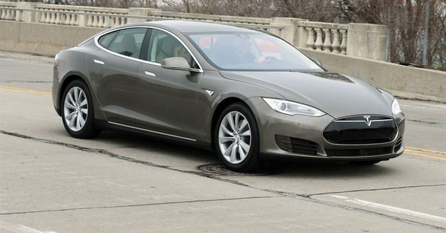 Tesla boosts range, power and price of low-end Model S