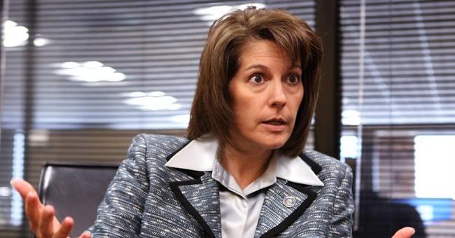 Former Nevada attorney general to run for Reid's Senate seat