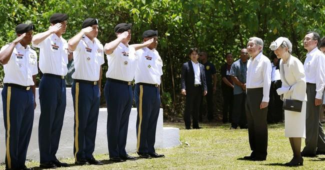 Japan's emperor prays at WWII battleground on Pacific island