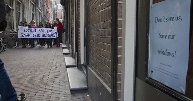 Amsterdam prostitutes protest closure of their windows