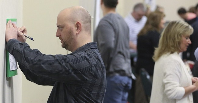 Applications for US jobless aid rise but still at low level