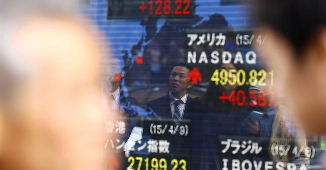 Asian shares mixed; Hong Kong, Japan benchmarks surge