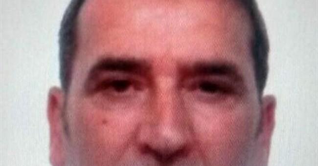 Gunman kills 3 in Milan court, raising security concerns