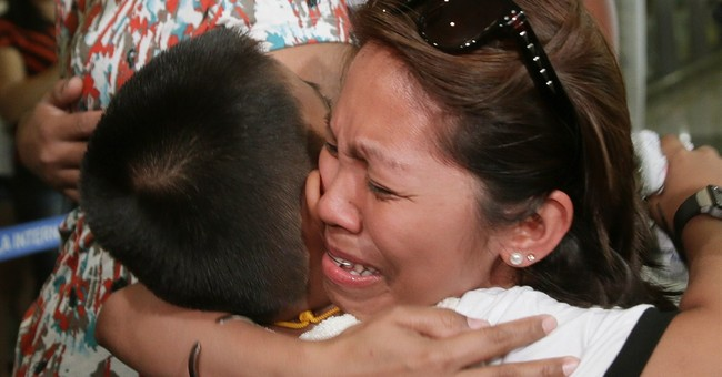 Image of Asia: A hug for a child after a long separation
