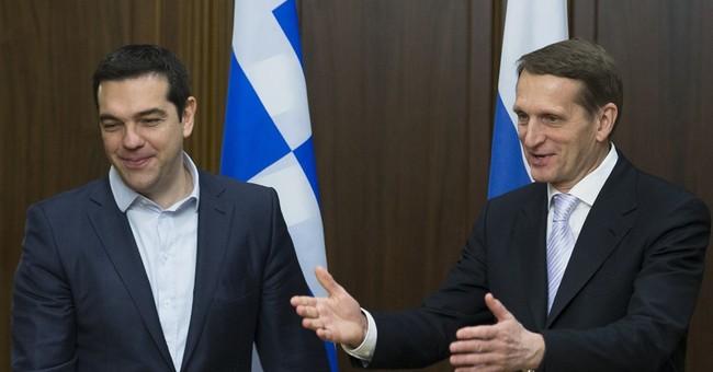 Putin gives visiting Greek PM Tsipras historic Greek icon