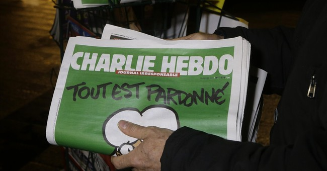 Terrific: Iranian President Defends Charlie Hebdo Attacks Before Heading to Paris