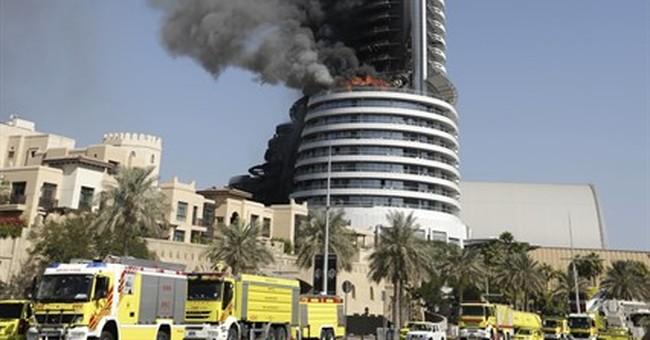 New Year's Eve skyscraper fire in Dubai smolders into 2016