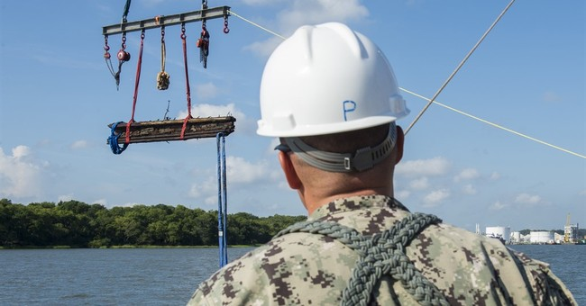 Half of artifacts from Confederate gunship returned to river