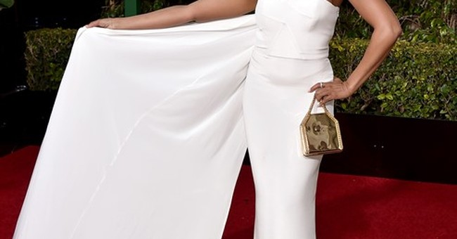 Winter whites, pops of yellow on the Golden Globes carpet