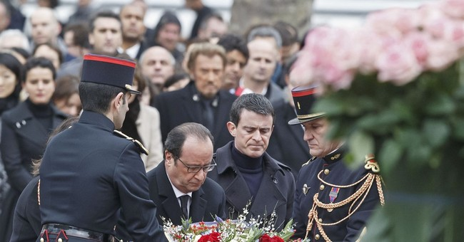 French president, rocker honor 2015 attack victims