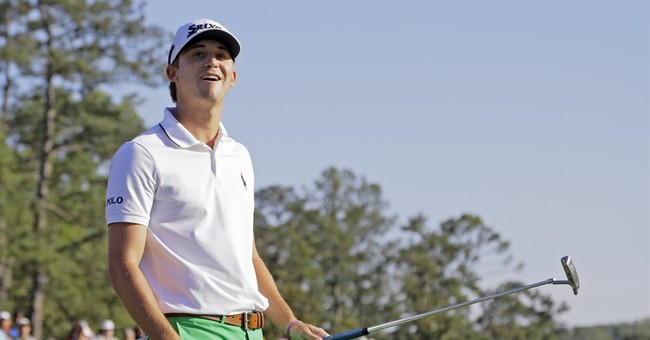 Spieth stumbles but still keeps Masters lead