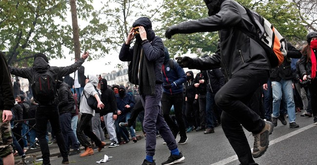 Tear gas, clashes mar French protests over labor law reforms