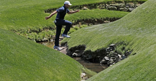 Spieth still on top, but faces Masters showdown with McIlroy