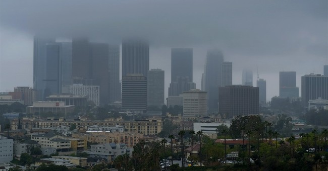 Showers delay California ballgame but won't ease drought