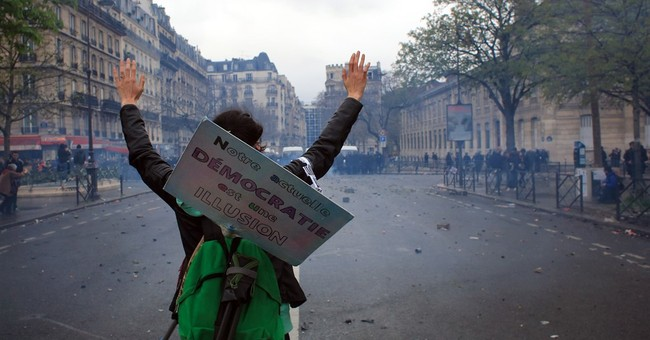 Paris police arrest 8 as protesters go on rampage in capital