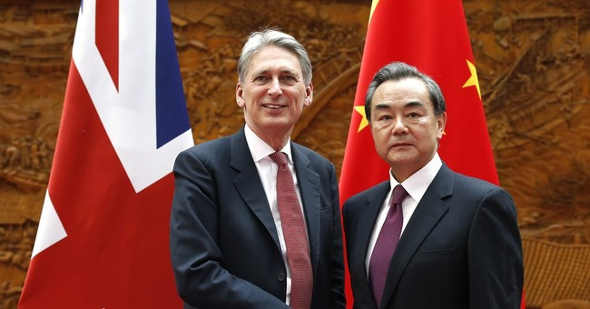 UK foreign minister urges China to cut steel capacity