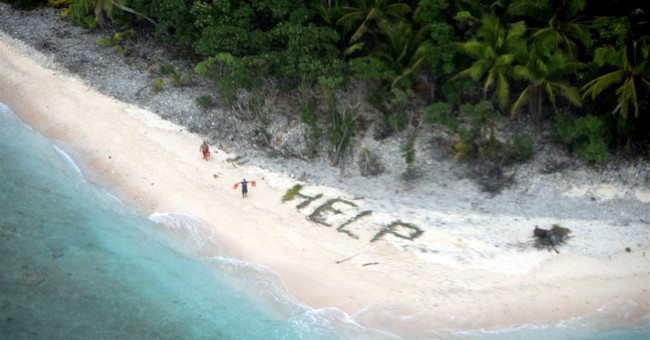 3 rescued from deserted island after writing 'help' on beach