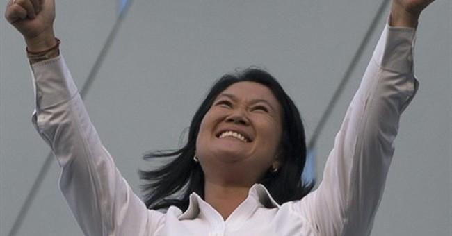 Fujimori wins first round of Peru election, heads to runoff