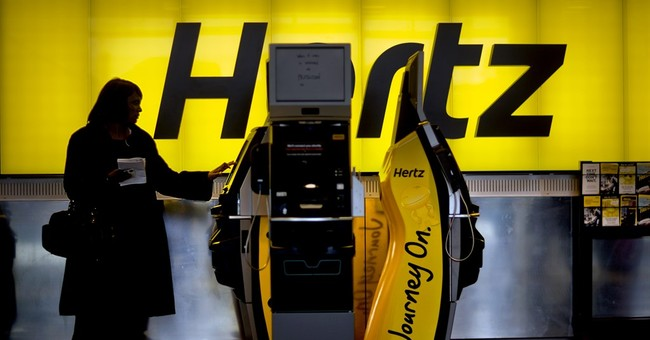 Hertz seeing a glut, trims revenue outlook; shares tumble