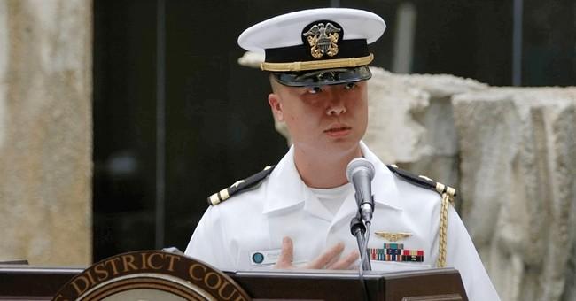 Navy officer accused of espionage; now held in Navy brig