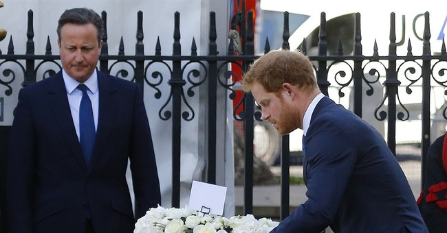 UK's Prince Harry lays wreath to Tunisia attack victims