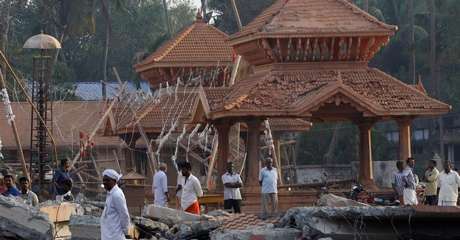 Indian police arrest 7 over temple fire that killed 116