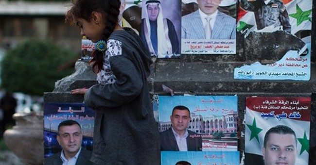 Syria pushes offensive on eve of elections, talks in Geneva