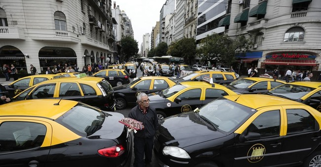 Argentina's Macri sides with taxi drivers against Uber
